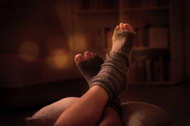 Woman's feet lying on pilow