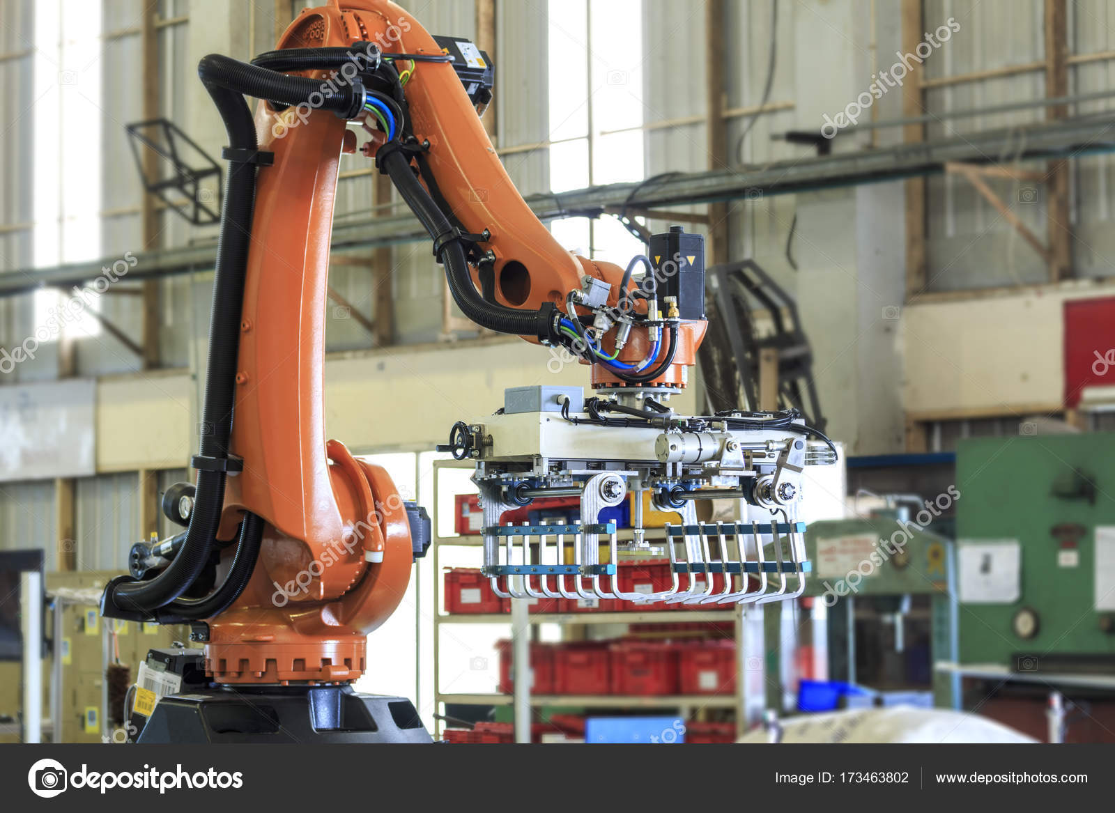 Industry 4 0 concept   Industrial picking robot in smart warehouse