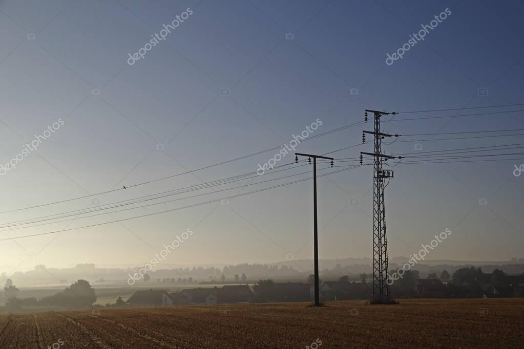 Electricity pylons in the morning, Upper Swabia, Baden-Wuerttemberg, Germany, Europe