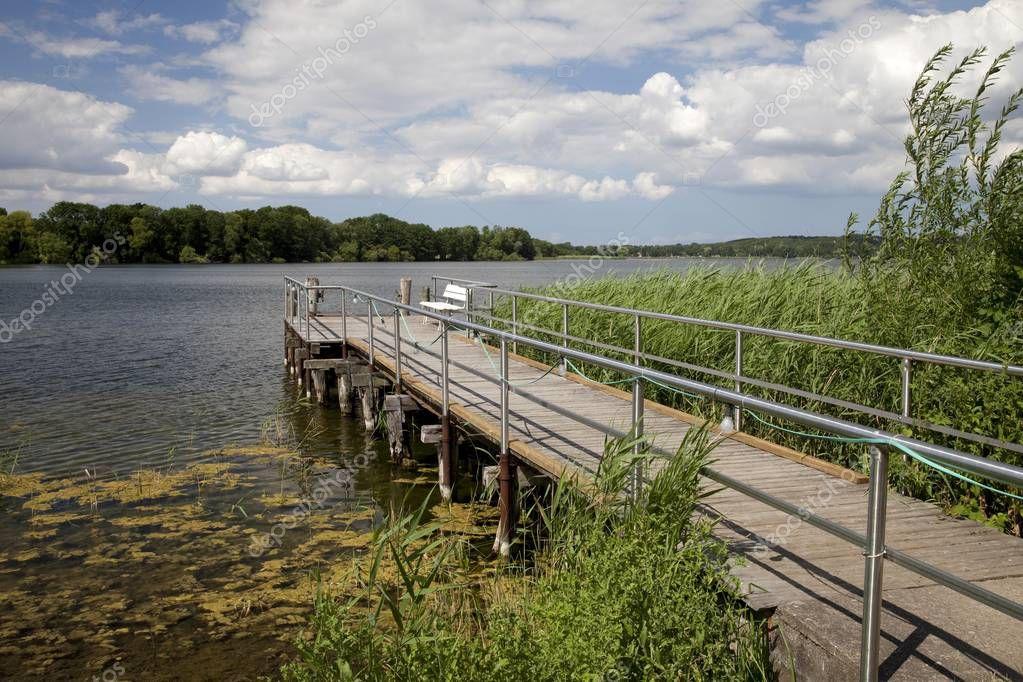 Jetty on lake Dieksee, Bad Malente-Gremsmuehlen, Holstein Switzerland Nature Park, Schleswig-Holstein, Germany, Europe