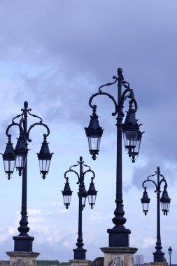 Lanterns, street lamps on Pont de Pierre bridge