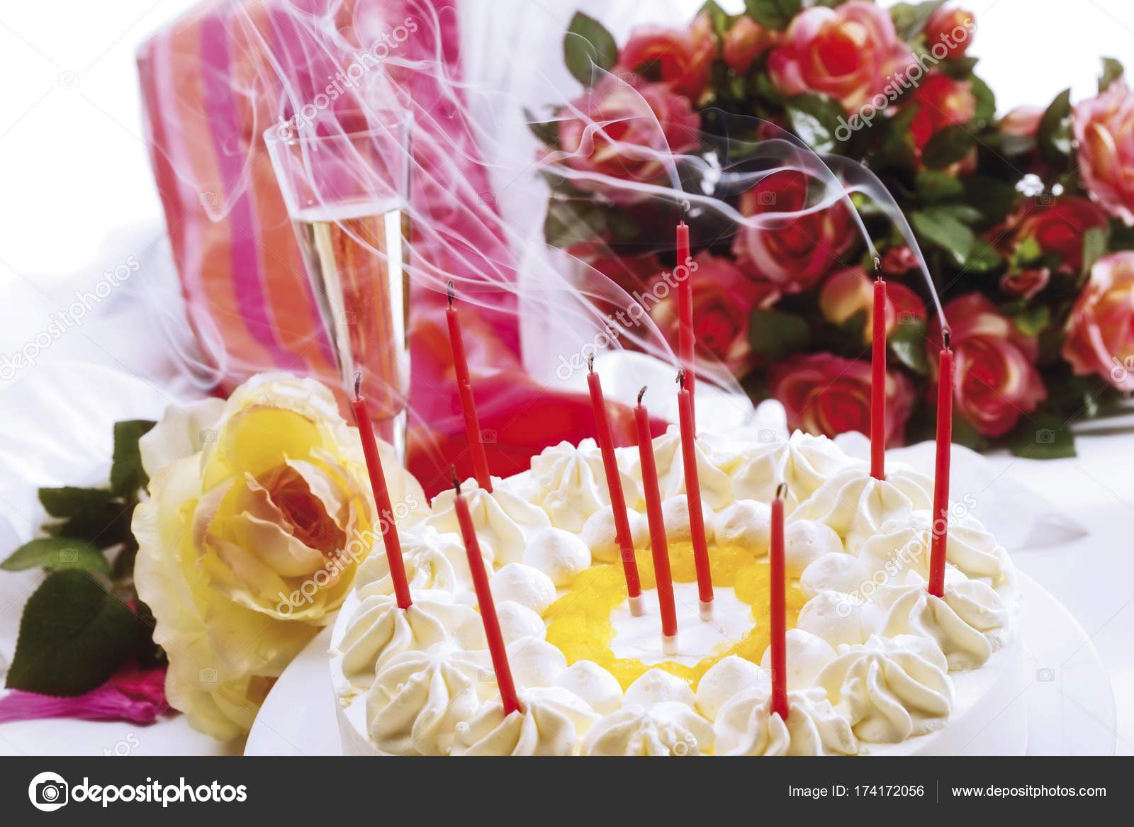 Blown out candles birthday cake bouquet roses gift background blown out candles birthday cake bouquet roses gift background stock photo izmirmasajfo