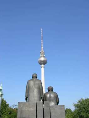 Karls Marx and Friedrich Engels Memorial in Berlin - Marx and Engels are looking towards the tv tower. stock vector