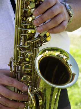 Man plays a saxophone view