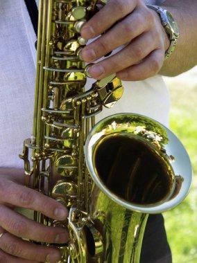 Man plays a saxophone view
