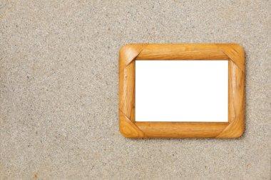 Wooden photo frame on stone limestone background
