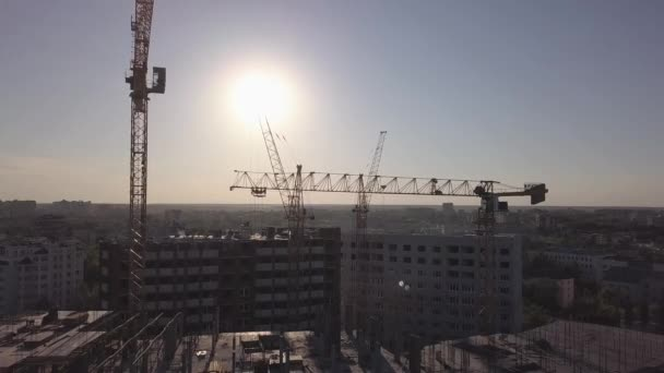 Aerial view of building cranes and buildings under construction