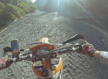 Enduro journey with dirt bike high in the mountains
