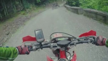 Enduro journey with dirt bike high in the Caucasian mountains with Buggy