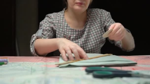 Close up footage of working tailor