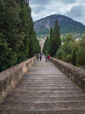 Pollenca, Spain, - May 25, 2019: 365 steps of Carrer del Calvari stairway leading to the El Calvari chapel at Pollenca, Mallorca, Spain