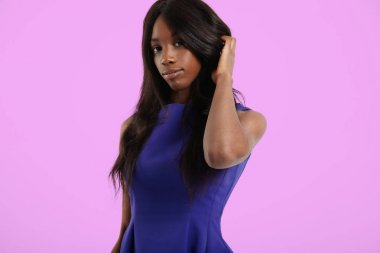black woman with long straight hair.