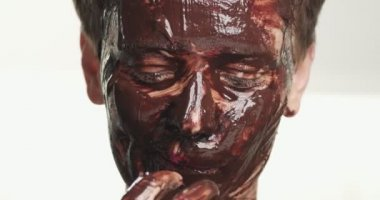 Woman with a chocolate facial mask