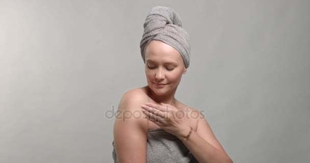Woman applying body cream