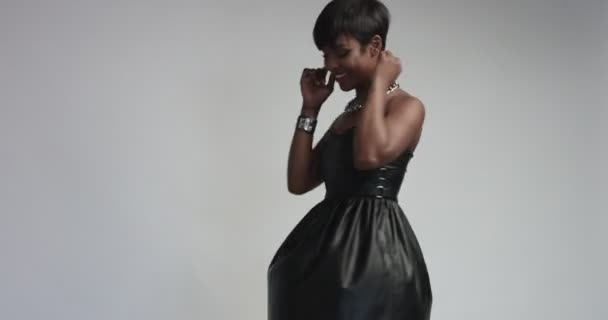 Hot black model wearing black leather dress