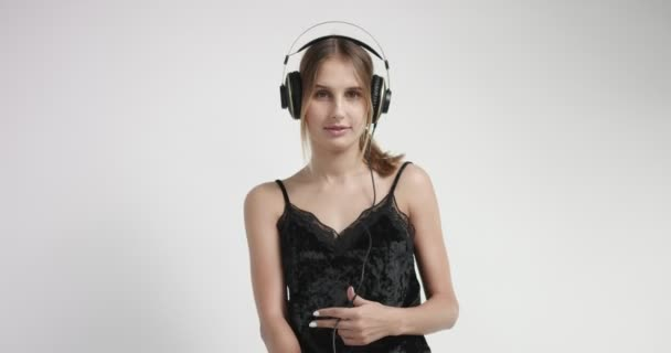 Attractive blond girl in loungewear and headphones