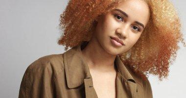 Attractive African model in khaki raincoat