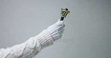 Hand holding golden bell