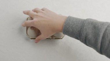 womans hand open an eggbox
