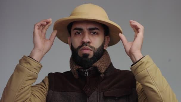 weird man in jacket and african hat in studio