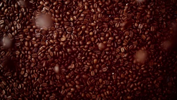 top view of coffe beans falling from camera down to coffe beans background