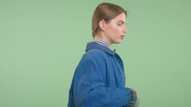 Fashion editorial portrait of blonde model wears a deep blue jacket Authentic vintage urban style