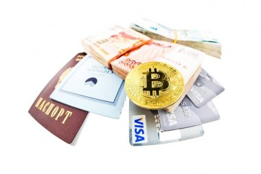 Bitcoin coin, Visa plastic cards and bank book of Sberbank
