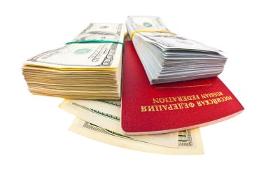 Passport of Russian Federation and stacks of American dollars isolated on white