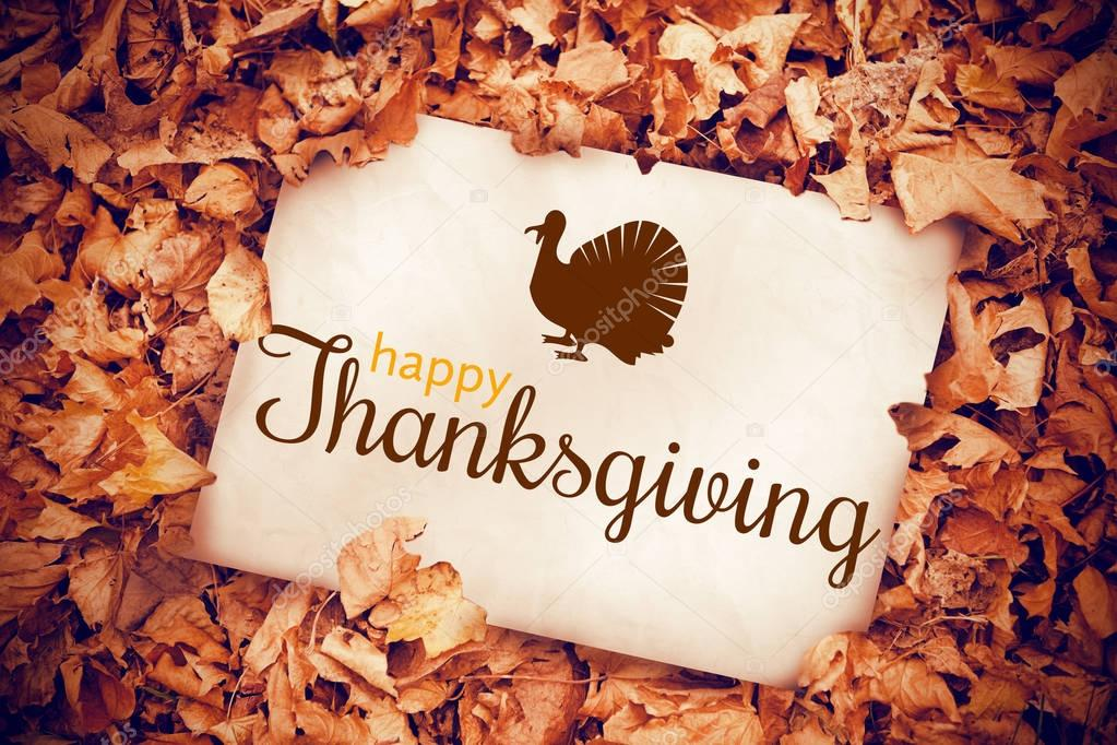 Thanksgiving greeting poster with turkey stock photo digital generated image of thanksgiving greeting against white poster buried into dead leaves photo by wavebreakmedia m4hsunfo