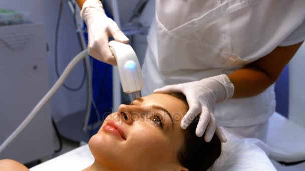 Doctor performing laser hair removal — Stock Video ...