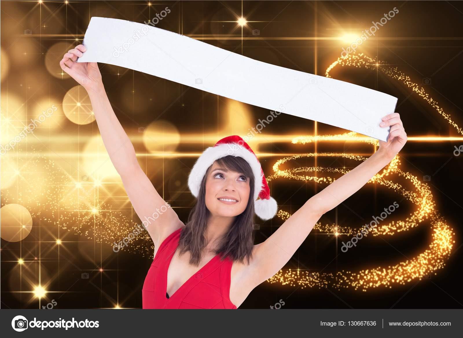 Kerstmuts Met Licht : Vrouw in kerstmuts houden een spandoek u stockfoto