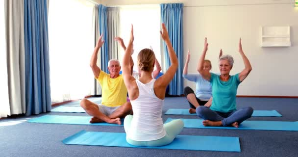 Trainer Assisting Senior Citizens In Practicing Yoga Stock Video C Wavebreakmedia 135202912