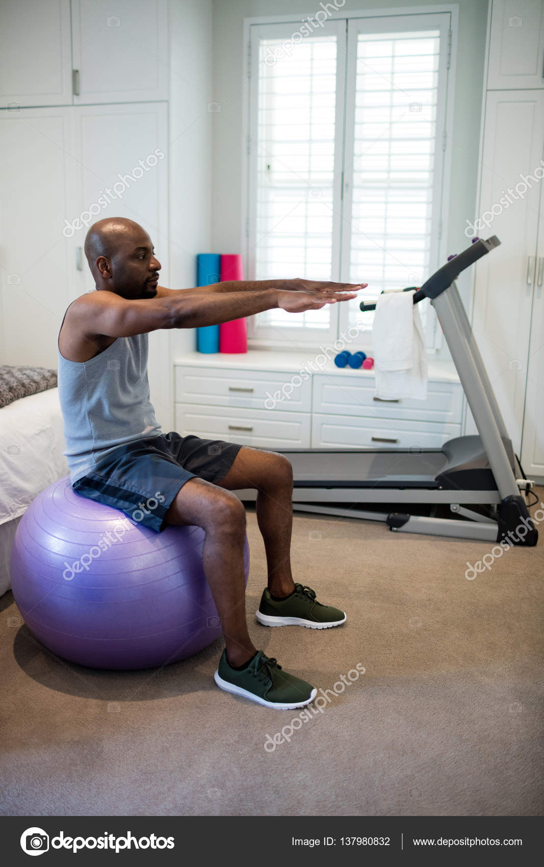 Man Exercising On Fitness Ball In Bedroom U2014 Stock Photo