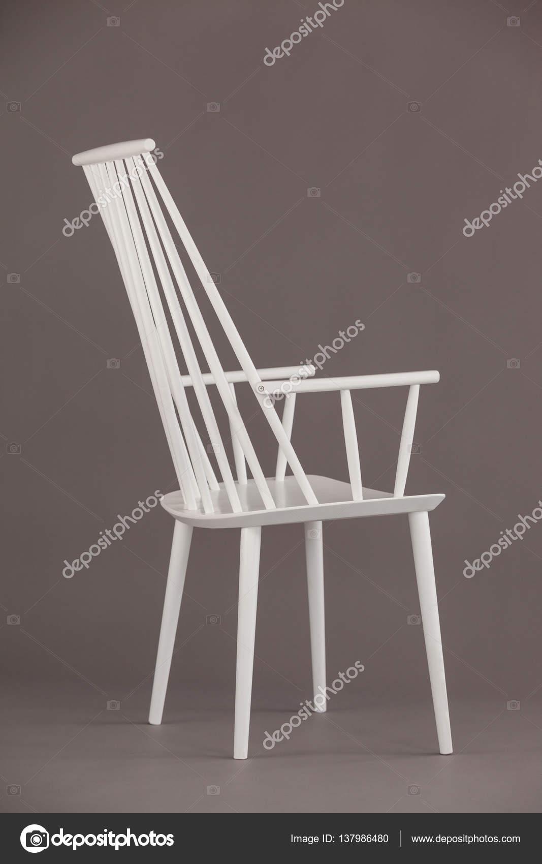 Weißer Stuhl Gegen Grau Stockfoto Wavebreakmedia 137986480