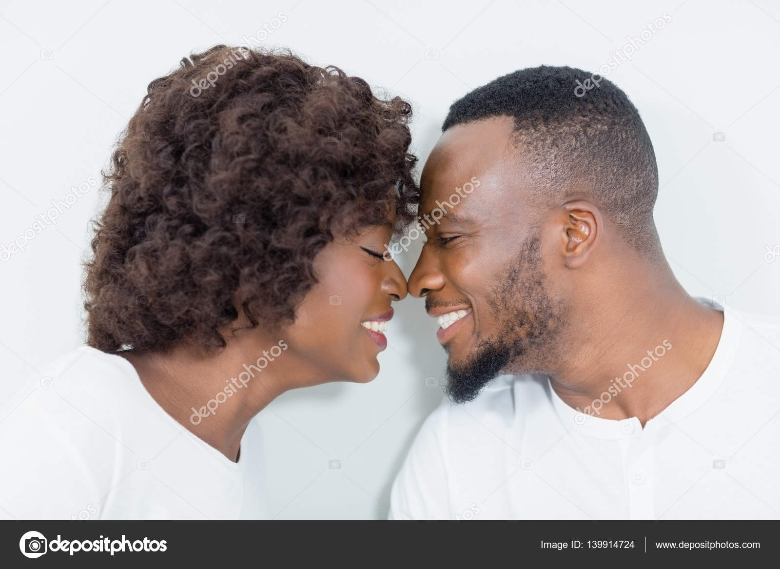 couple romancing face to face in bedroom stock photo