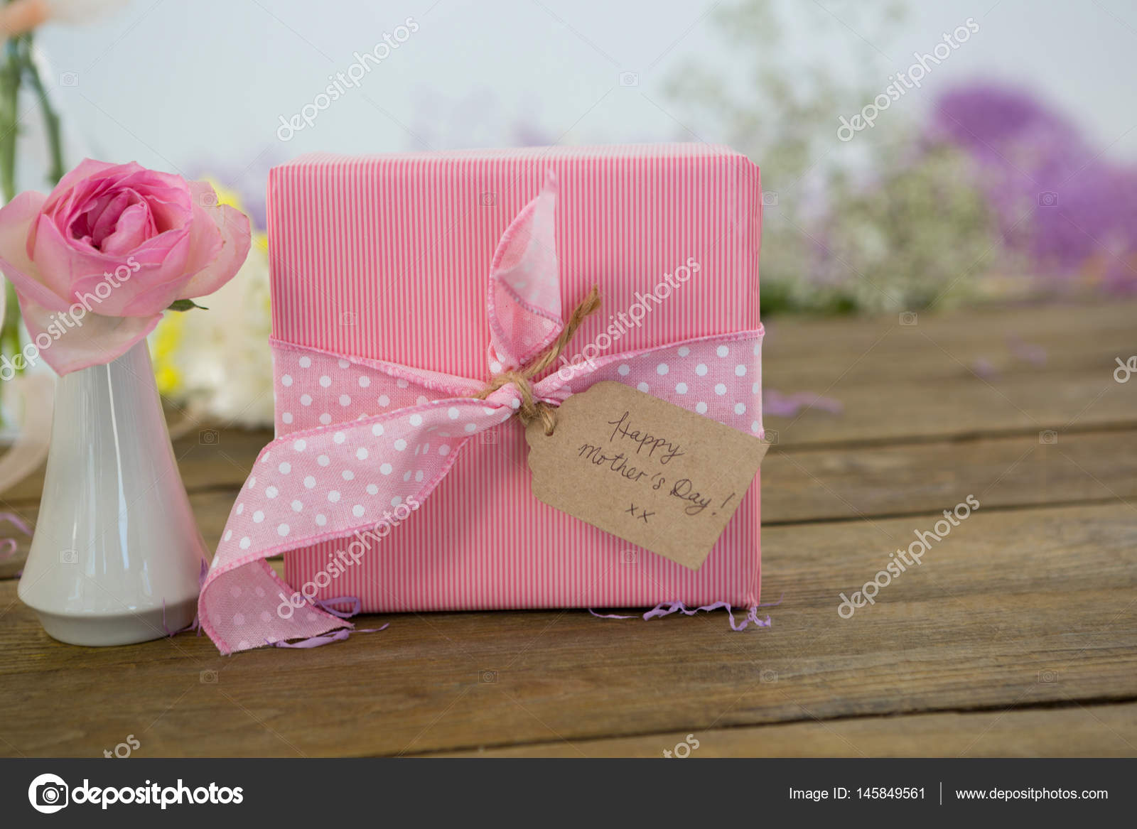 Gift box and flower vase on wooden surface — Stock Photo ...