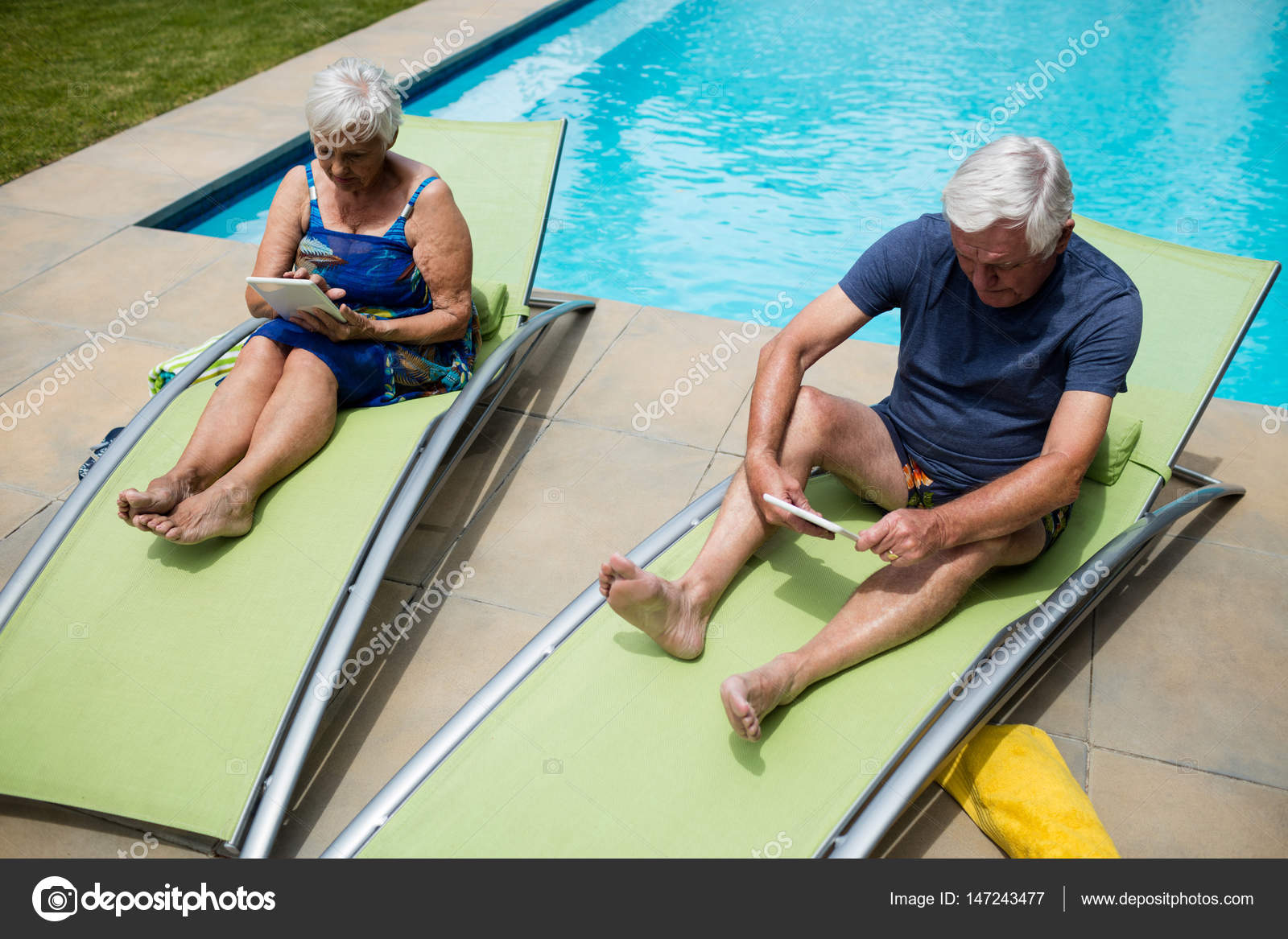 Senior couple using digital tablet on lounge chair u2014 Stock Photo & Senior couple using digital tablet on lounge chair u2014 Stock Photo ...