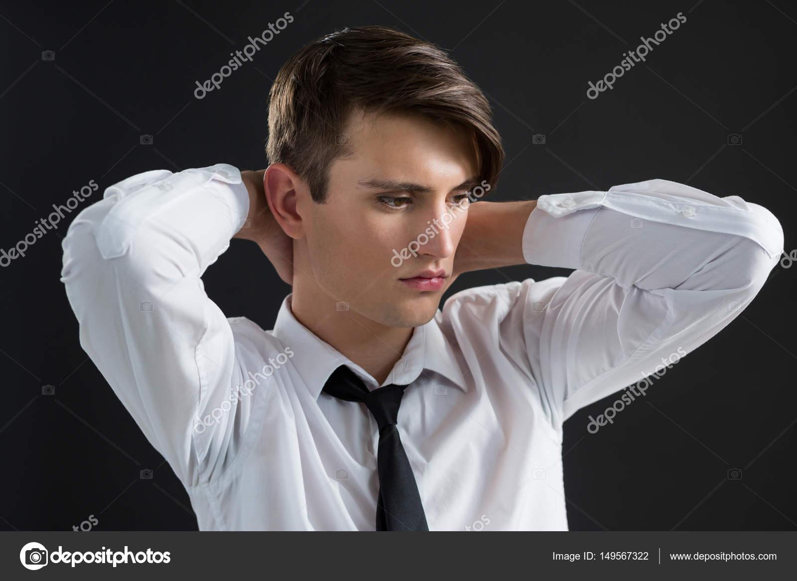 androgyne homme avec les mains sur son cou photographie wavebreakmedia 149567322. Black Bedroom Furniture Sets. Home Design Ideas