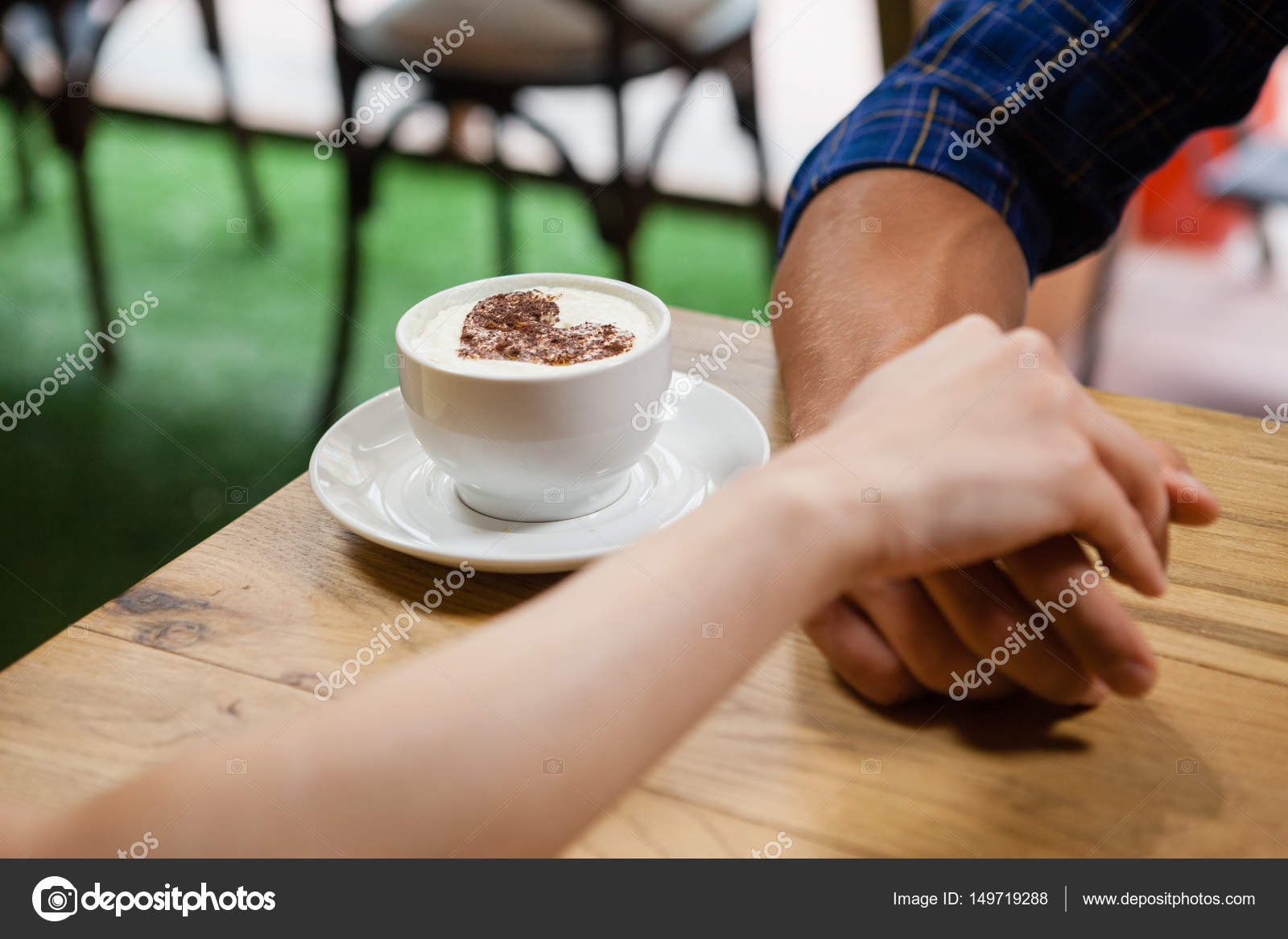 Couple holding hands by coffee on table stock photo close up of couple holding hands by coffee cup on table photo by wavebreakmedia geotapseo Gallery