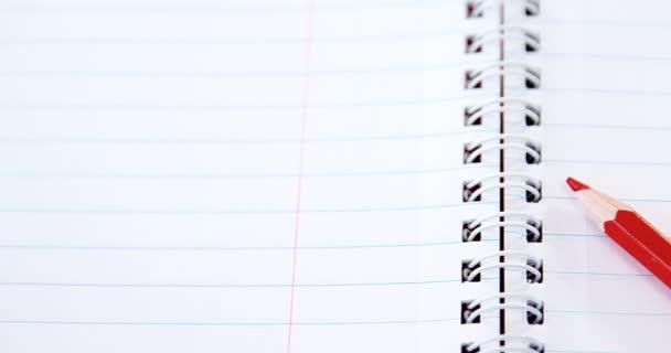 Lápiz de color rojo en el libro — Vídeos de Stock © Wavebreakmedia ...