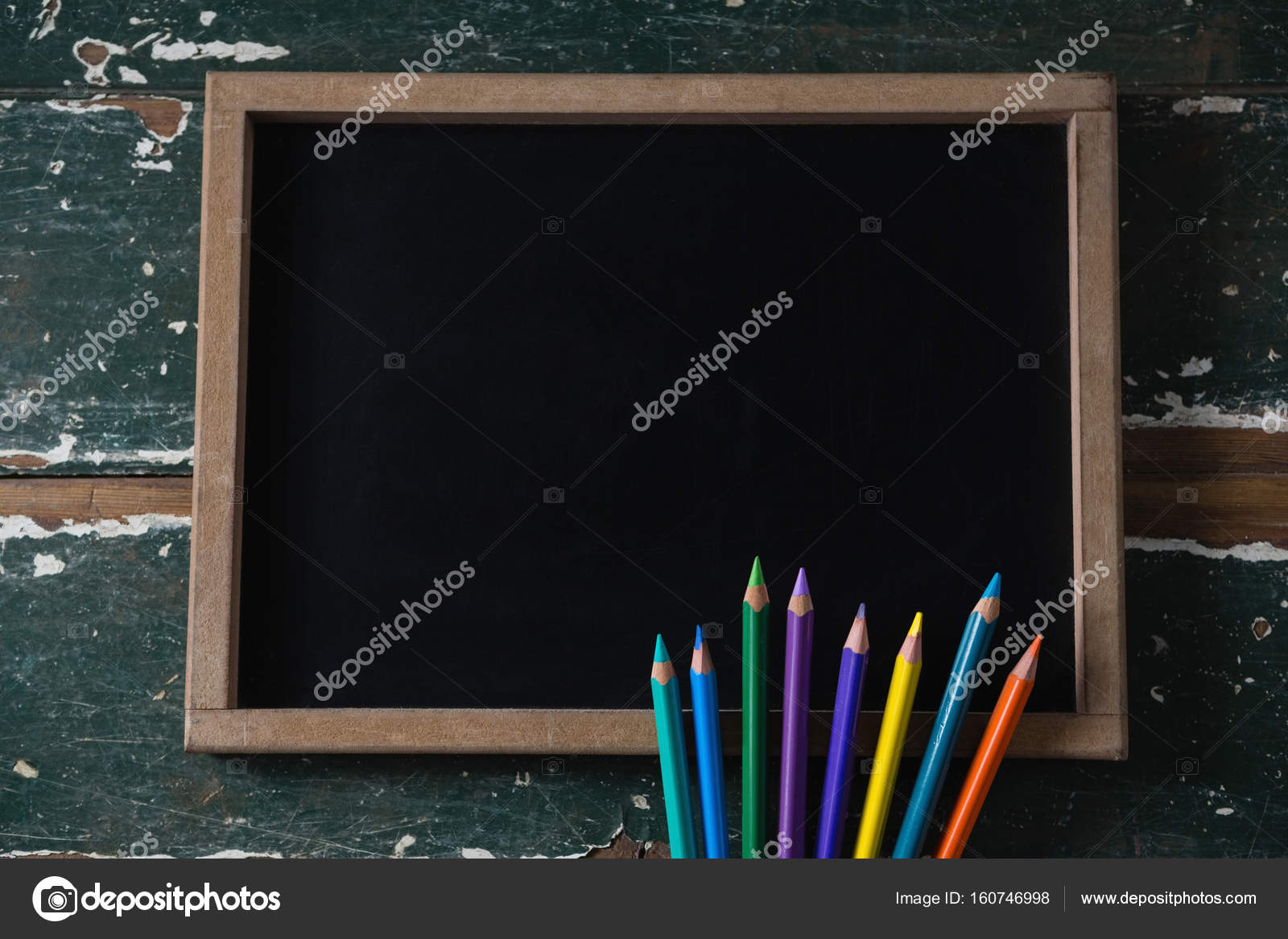 blank chalkboard and various colored pencil stock photo