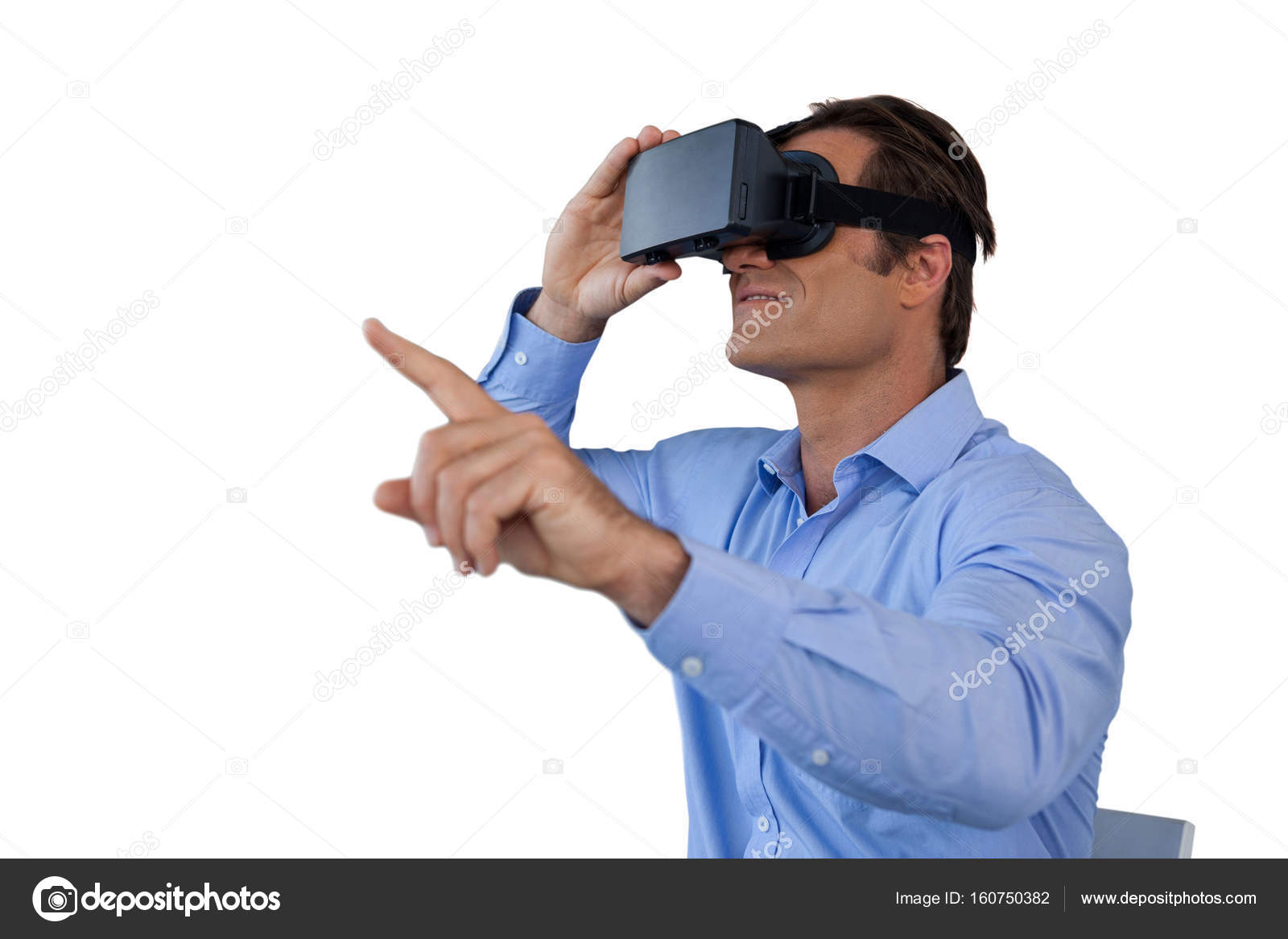 dbf2b053cfe Businessman gesturing while using virtual reality simulator against white  background — Photo by ...