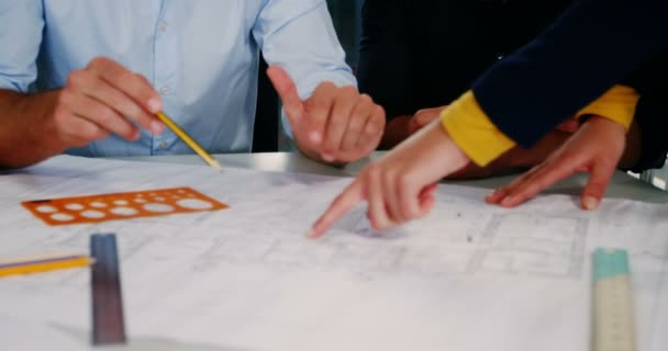 Business executives discussing over blueprint stock video business executives discussing over blueprint stock video malvernweather Image collections