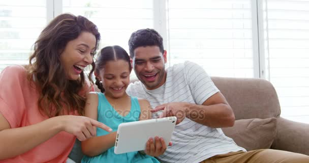 Family Sitting On Sofa And Using Digital Tablet U2014 Stock Video