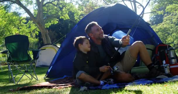 Father ...  sc 1 st  Depositphotos & Father and son holding a fishing rod outside the tent u2014 Stock ...
