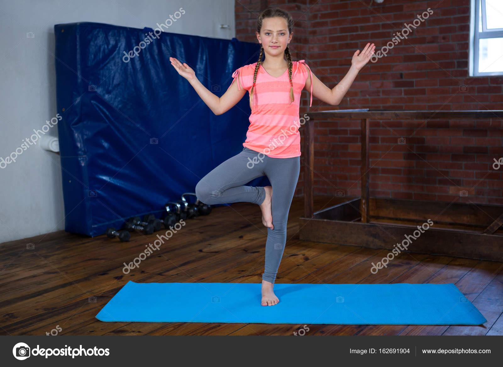 Teenage Girl Practicing Yoga Stock Photo C Wavebreakmedia 162691904