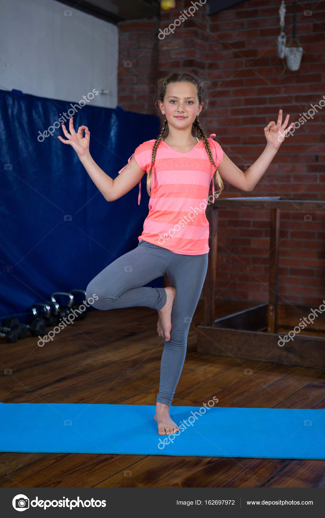 Teenage Girl Practicing Yoga Stock Photo C Wavebreakmedia 162697972