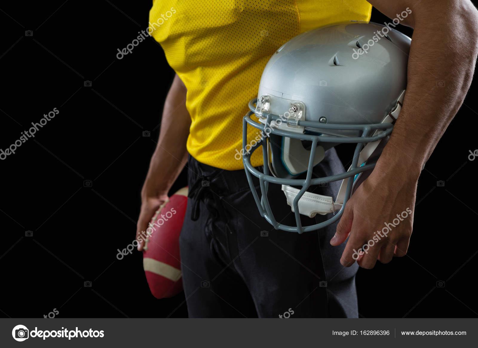 f220fd7b7 bola de exploração de jogador de futebol americano — Fotografias de ...