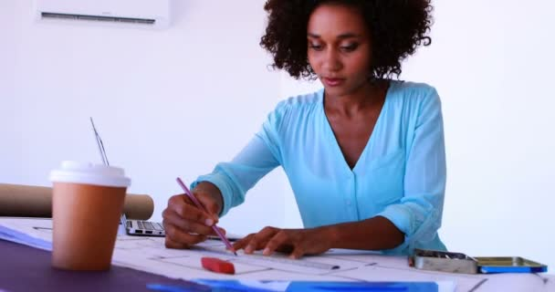 Architect working on blueprint over drafting table stock video female malvernweather Choice Image
