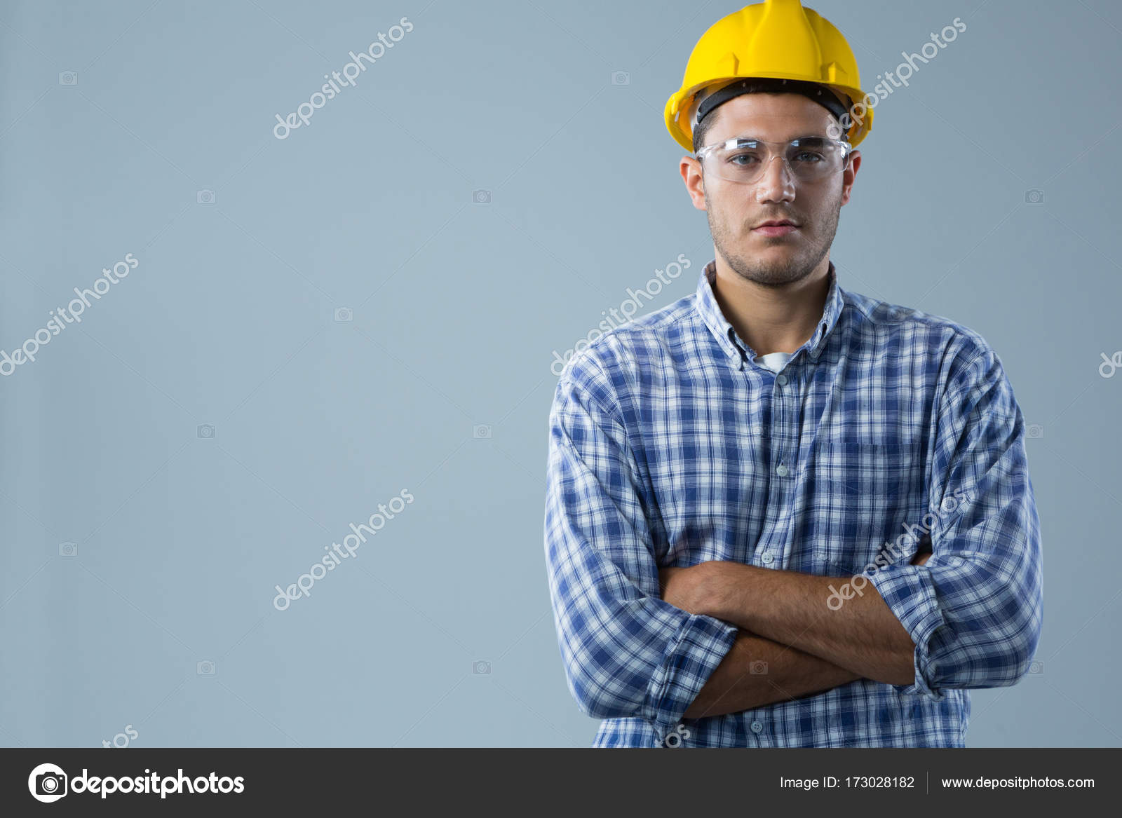 Architect Standing With Arms Crossed Stock Photo